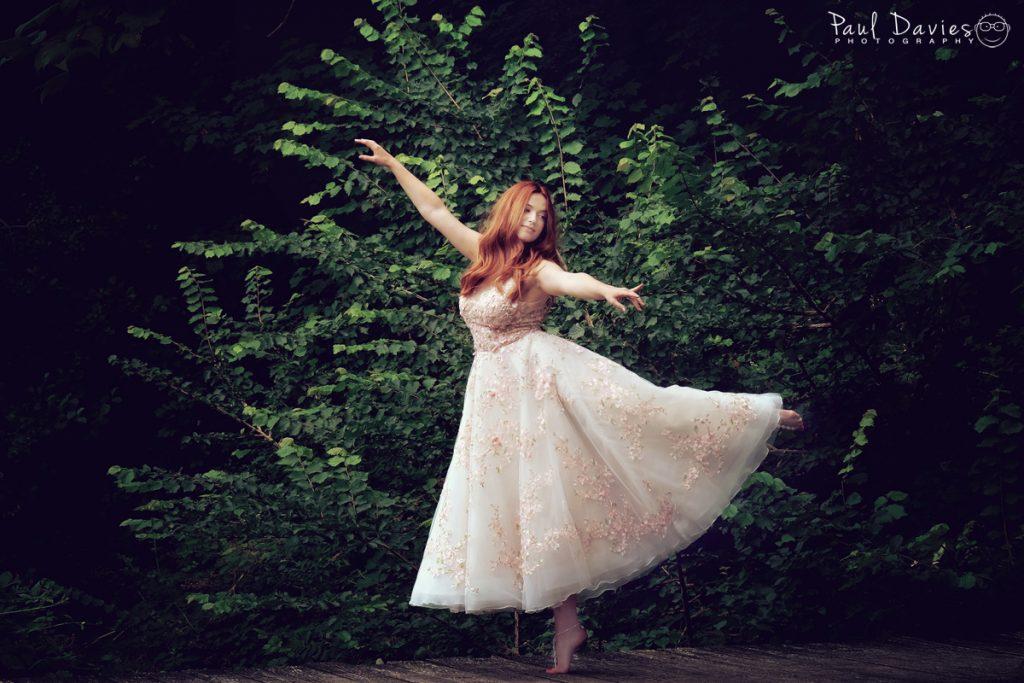 Wedding dress shoot at Fairyhill Gower. Dancing on bridge